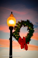 The lights are on in Whitney Commons - including the lights on the Christmas Wreath as the sun sinks in the west