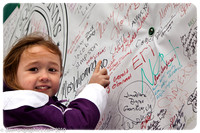 "Young Katelyn Reckard points to her name on the ""Christmas Tree Truck"""