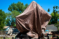 "The covered bronze sculpture ""Good Ride Cowboy"" that will be unveiled at 3:00 pm."