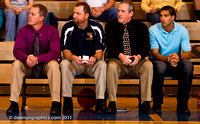 The Bronc coaches watch the warm-ups